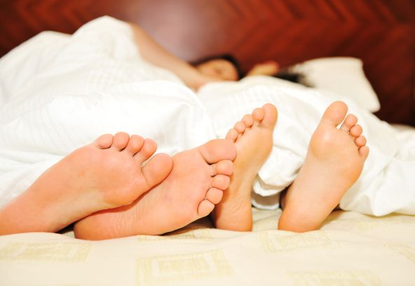 Couple's feet whilst in bed