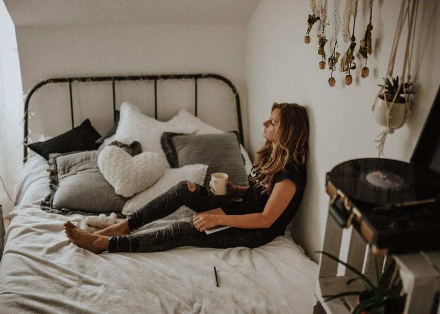 quarantine-dates-woman-bed-coffee