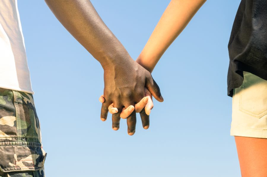 Interracial Dating Couple Holding Hands