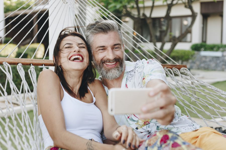 Woman and mature man taking selfie